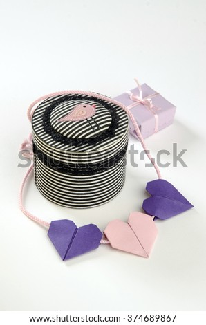 gifts for the holiday Valentine's Day box of origami heart on a white background - stock photo