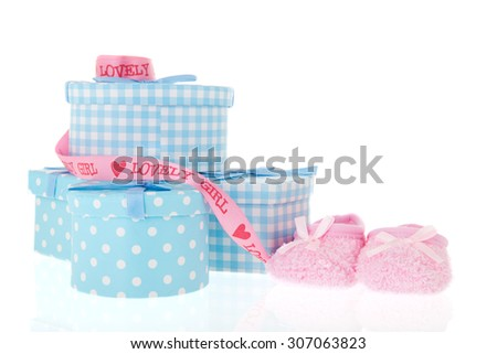 Gifts for the newborn baby in blue isolated over white background - stock photo