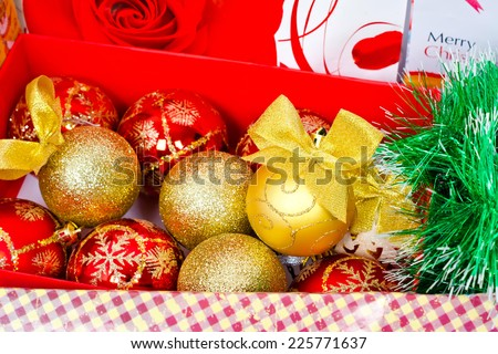Gifts in festive packaging, decoration for Christmas tree, shiny balls with bows - stock photo