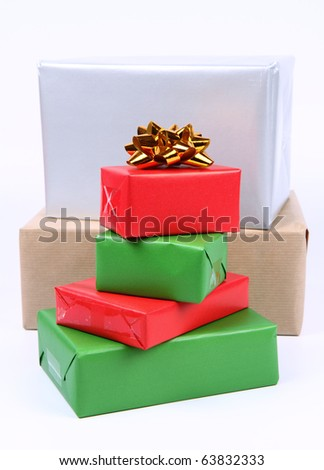 Gifts in small and big boxes in silver, brown, green and red wrapping  on white background - stock photo