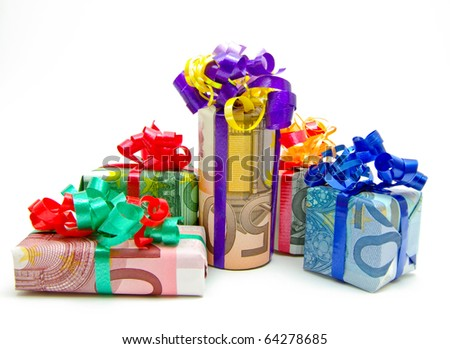 Gifts packed in euro bills - stock photo