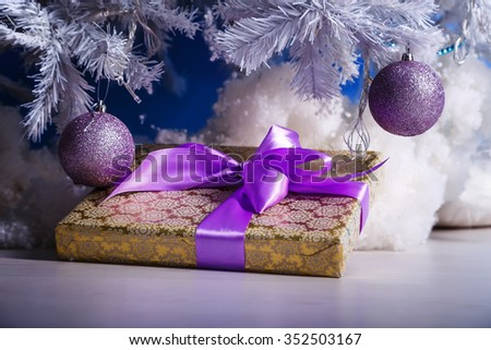 Gifts tied with ribbons under a Christmas tree - stock photo