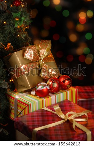 Gifts under the Christmas tree lights background - stock photo