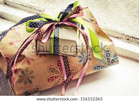 gifts with packaging paper and atlas bows/vintage holiday background - stock photo