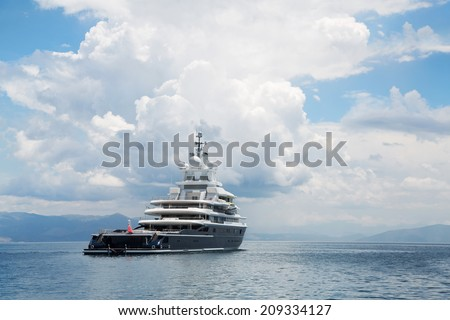 Gigantic big and large luxury mega yacht with with helicopter landing place on the blue ocean. - stock photo