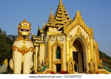 gigantic Leogryph sculpture at Buddhist Shwedagon pagoda west entrance, Yangon Rangun Myanmar Burma - stock photo