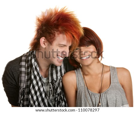 Giggling young teenage couple over white background - stock photo