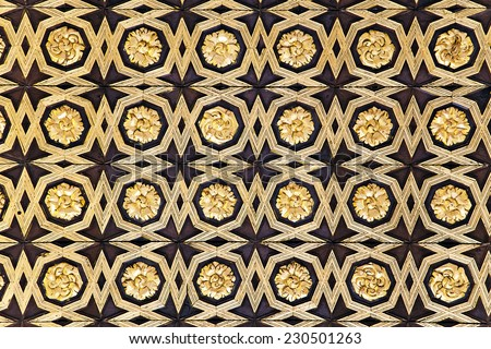 Gild wallpaper in Alcazar palace in Seville, Spain - stock photo