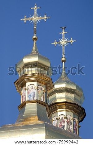 Gilded cupolas with crosses of the the Assumption Cathedral at Kiev Pechersk Lavra Orthodox monastery, Ukraine - stock photo