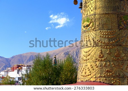 Gilded dhvaja-victory banner and Potala on the background. Rooftop of  the AD.642 founded-25000 m2 Jokhang-House of Buddha temple. Lhasa-Tibet. - stock photo