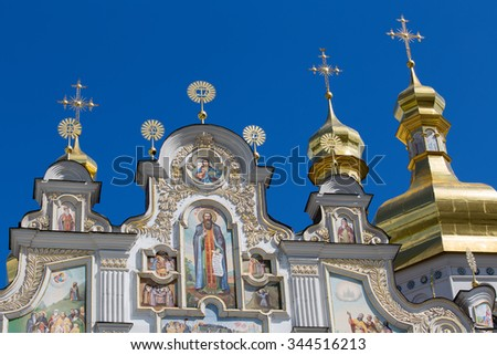 Gilded dome with a cross in the Assumption Cathedral in Kiev Pechersk Lavra Orthodox monastery, Ukraine - stock photo