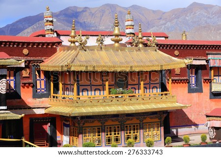 Gilded roofs and decoration -dhvajas-lotus flowers-makaras-garudas- atop oriel in the courtyard of the AD.642 founded-25000 m2 Jokhang-House of Buddha temple. Lhasa-Tibet. - stock photo