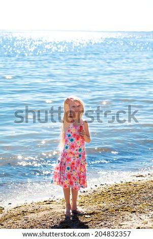 gilrl with soap bubbles on the seashore - stock photo