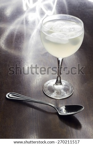 Gin and tonic photographed with slow shutter at night club - stock photo