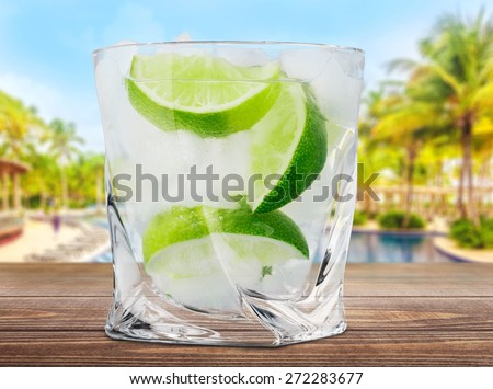 Gin. Cocktail with ice and lime slice isolated on white background - stock photo