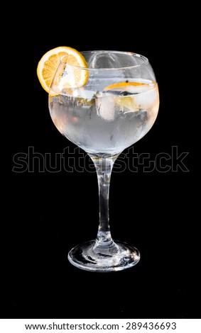 Gin tonic isolated on black background - stock photo