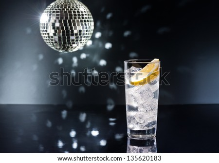 Gin Tonic Tom Collins on the dance floor - stock photo