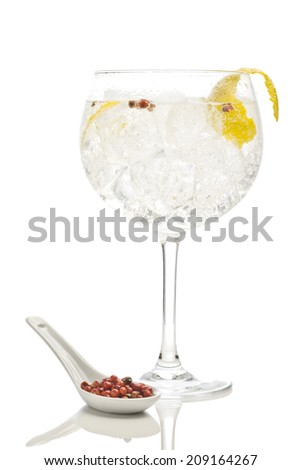 Gin tonic with pink pepper - stock photo