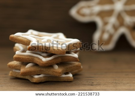 Ginger Bread Cookies with White Decoration as Christmas or Winter Background with Copy Space - stock photo