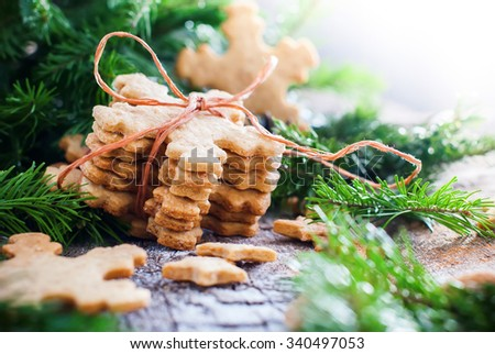 Ginger Cookies Snowflakes in Christmas Composition on Wooden Background decorated with Fir tree - stock photo