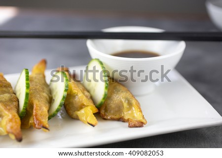 Ginger dumplings with pork shoulder, cucumber and sesame-soy - stock photo