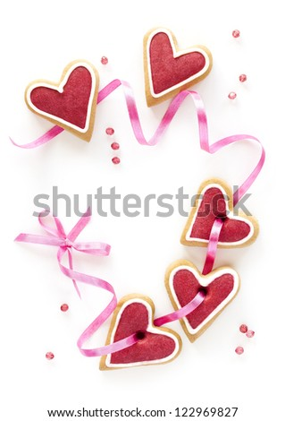 Ginger Heart shaped cookie for Valentine's Day with pink bow and ribbon. Isolated on white background. - stock photo