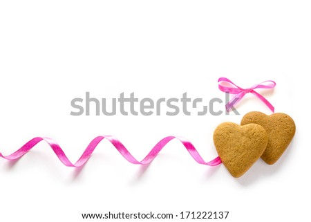 Ginger Heart shaped cookies for Valentine's Day with pink ribbon. Isolated on white background - stock photo