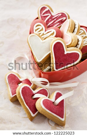Ginger Heart shaped cookies for Valentine's Day with white ribbon. Isolated on white background - stock photo
