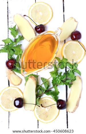ginger honey lemon mint cherry on a white wooden background ingredient for homemade lemonade rustic style flat look view from above over head - stock photo