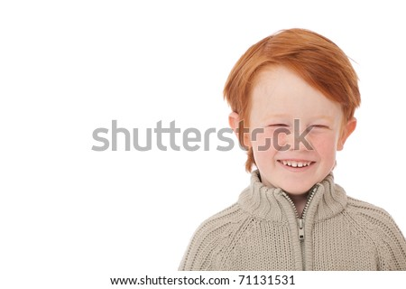 Ginger red hair haired boy funny face laughing isolated on white - stock photo