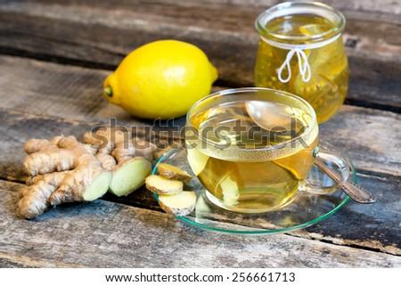 Ginger tea and fresh lemon - stock photo