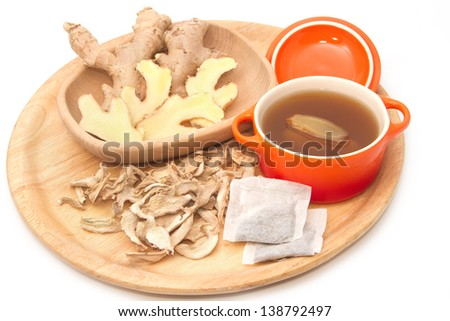 Ginger tea and ginger root ,fresh and dried herb - stock photo