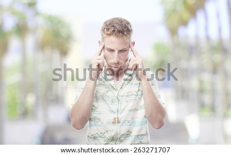 ginger young man with hawaiian shirt concentrated - stock photo