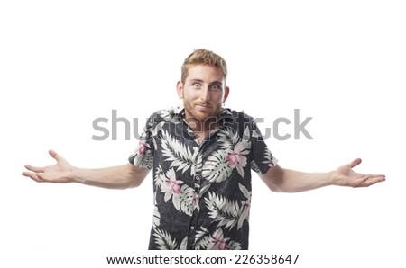 ginger young man with hawaiian shirt disinterested - stock photo