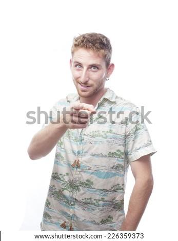 ginger young man with hawaiian shirt pointed at you - stock photo