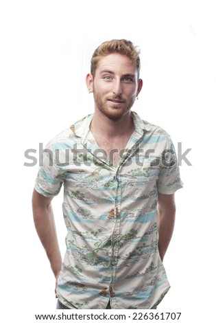 ginger young man with hawaiian shirt with self-confidence - stock photo