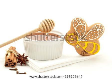 Gingerbread bee cookie and honey  - stock photo