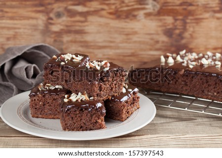 Gingerbread cake with chocolate and hazelnuts. Shallow dof - stock photo