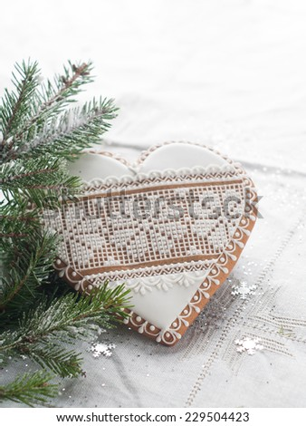 Gingerbread Christmas heart with decoration, selective focus - stock photo