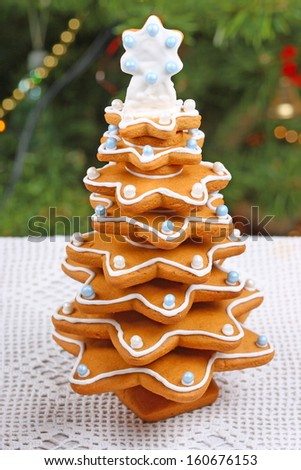 Gingerbread Christmas tree on white tablecloth  - stock photo