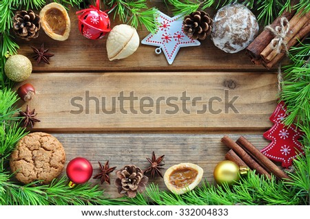 Gingerbread cookie and spices over wooden background  - stock photo