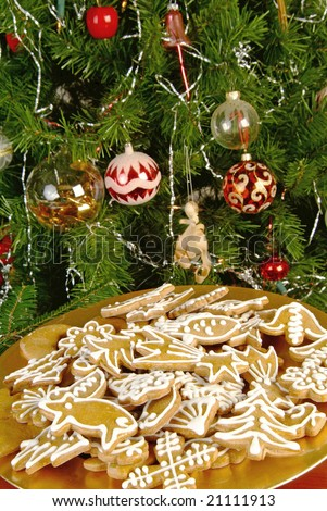 Gingerbread Cookies and Decorated Christmas Tree - stock photo