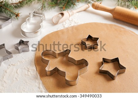 Gingerbread cookies dough with spices preparation recipe, cinnamon rolling pin and flour on white kitchen table. Traditional homemade christmas dessert - stock photo