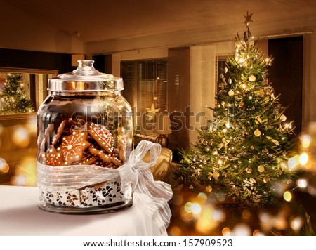 Gingerbread cookies jar Christmas tree room background - stock photo