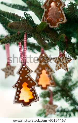 Gingerbread cookies on Christmas tree - stock photo