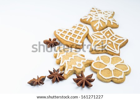 Gingerbread cookies with spices isolated on white background - stock photo