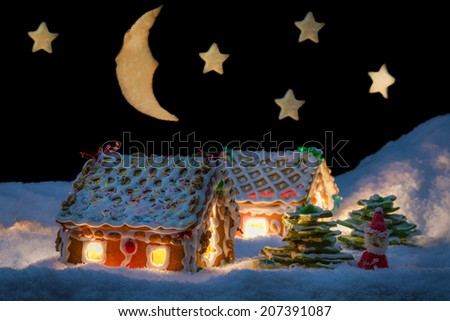 Gingerbread cottage in winter with stars - stock photo