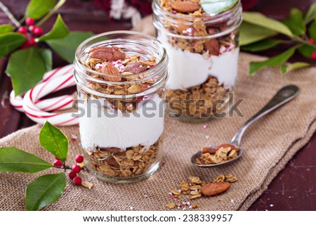 Gingerbread granola parfait with yogurt and crushed candy cane - stock photo