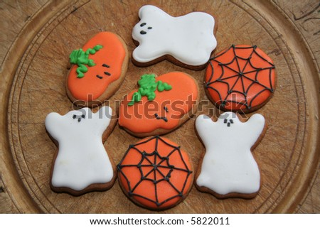 Gingerbread Halloween Biscuits on a wooden tray ready to eat - stock photo