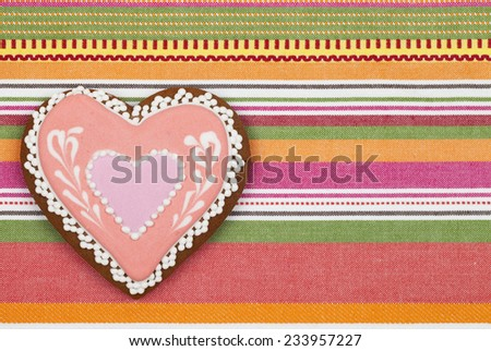 Gingerbread heart on fabric background  - stock photo